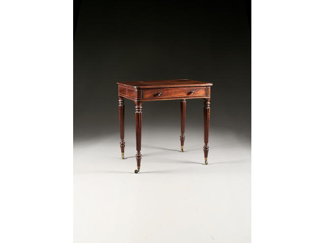 A Gillows Regency mahogany writing table, of small proportions