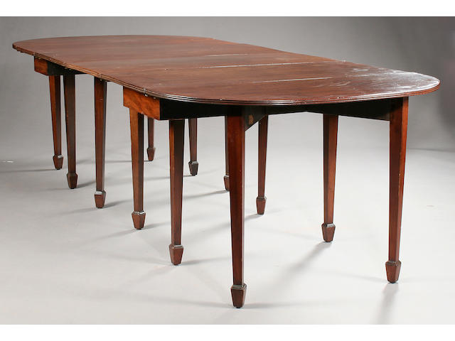 A George III mahogany 'D' end dining table,
