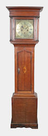 A George III oak and mahogany crossbanded longcase clock