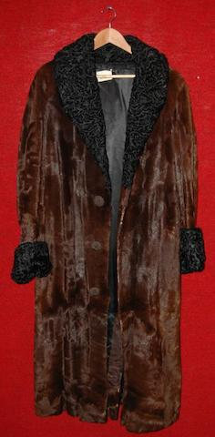 Dirk Bogarde from The Fixer, 1968 A three quarter length mink fur coat,