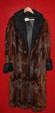 Dirk Bogarde from The Fixer, 1968 A three quarter length mink fur coat,