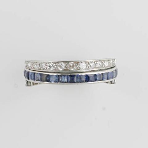 A sapphire, emerald and diamond swivel eternity ring