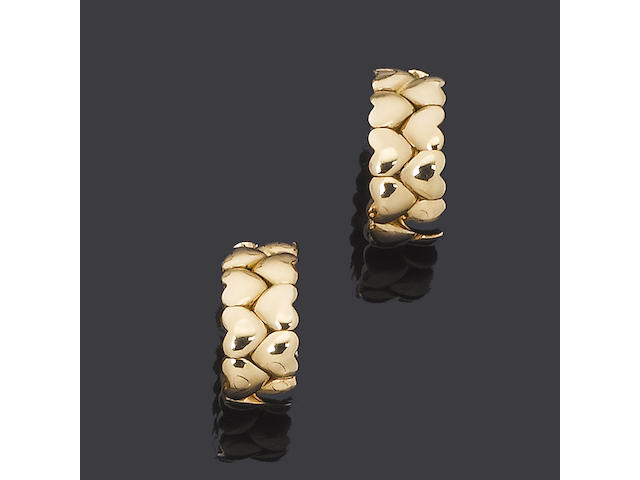 A pair of 18 carat yellow gold earrings, by Cartier