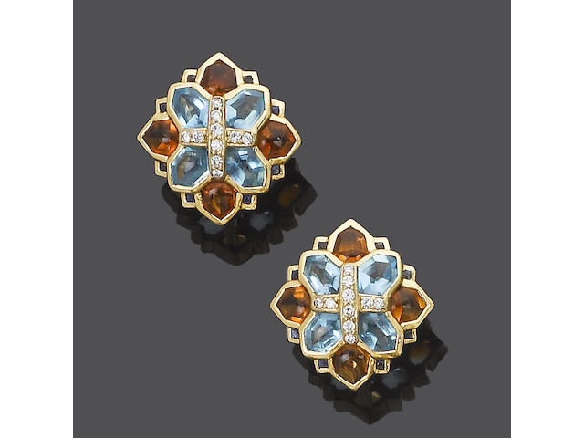 A pair of diamond and gem-set earrings, by David Morris (see illustration)