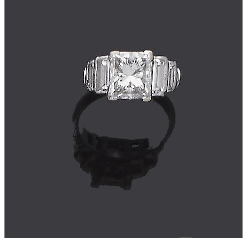 A princess-cut diamond single-stone ring, by Theo Fennell