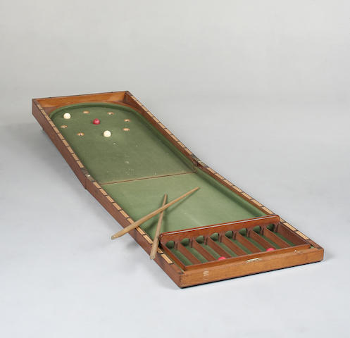 An early 20th Century mahogany bagatelle table,