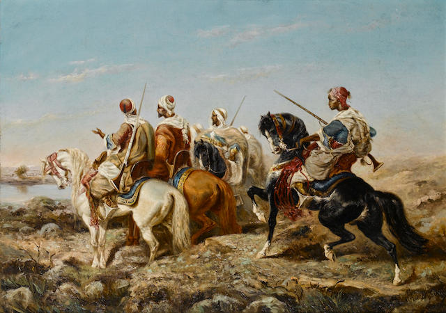 Alfred Durieux (French, 19th century) Arab horsemen approaching a river 50.8 x 71.2 cm. (20 x 28 in.)