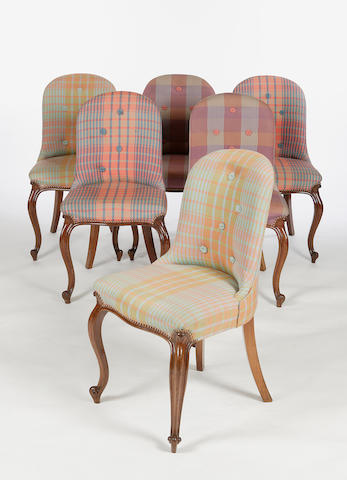 A set of six Edwardian upholstered tub armchairs