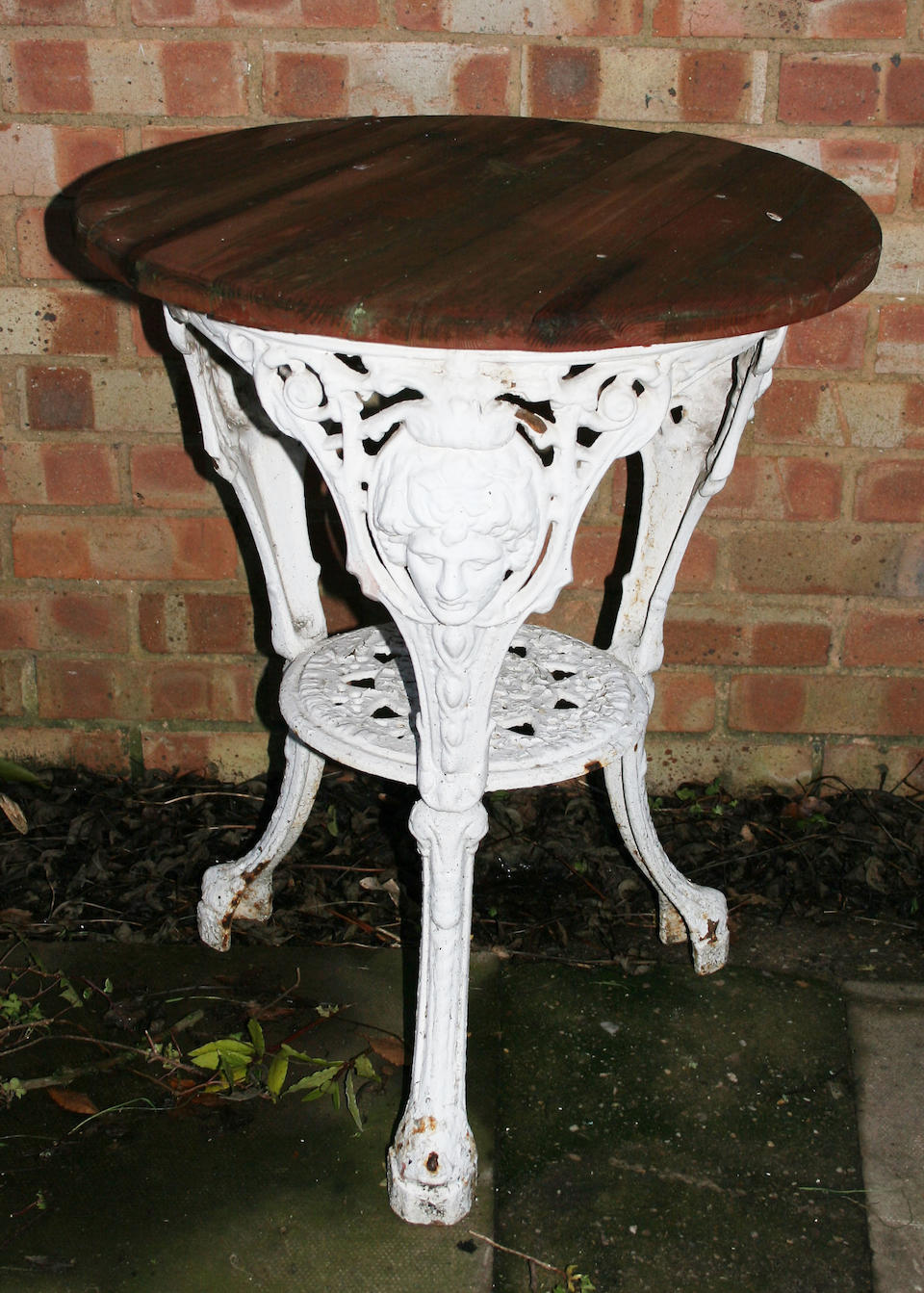 A set of three cast aluminium white painted garden chairs