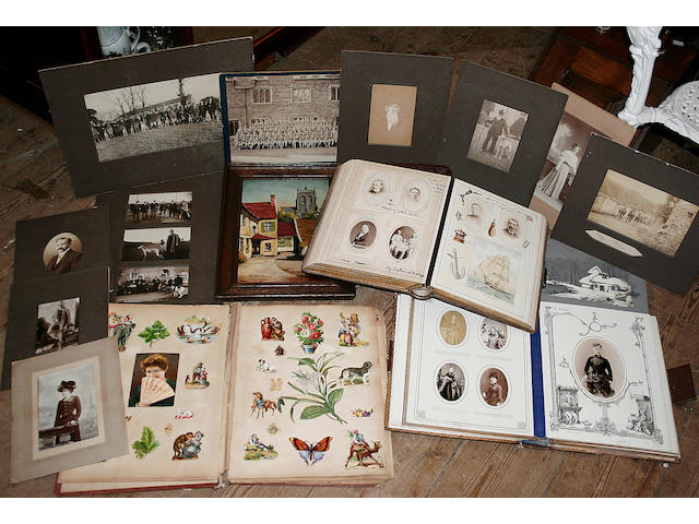 An oil on panel, study of a church, initialled R.M; three Victorian photograph albums containing portrait photographs; a selection of unframed early 20th century photographs of horses and dogs, and a Victorian scrap album