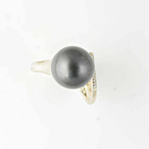 A South Sea cultured black pearl and diamond ring