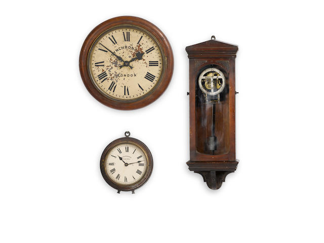 A 20th century master clock and two slave dials Synchronome