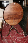 An early 19th Century oak and mahogany wine table