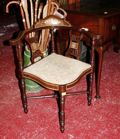 An Edwardian mahogany corner chair