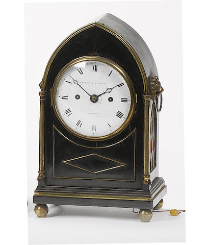 An early 19th century ebonised lancet clock of small size Grayhurst and Harvey, London