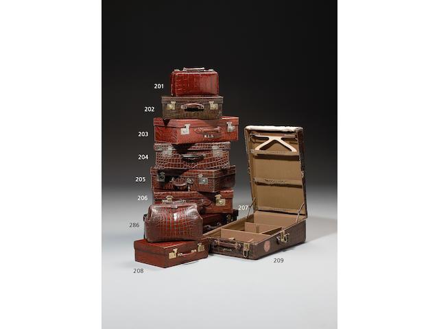 A Victorian brown crocodile leather Gladstone bag,