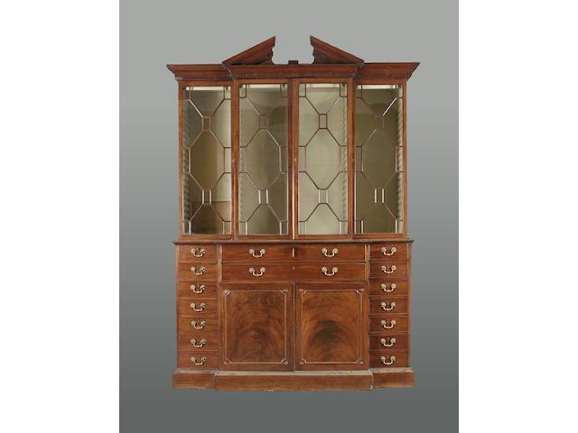 A George III mahogany breakfront secretaire bookcase