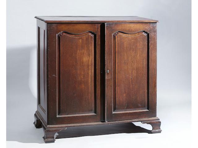 A George III gentleman's mahogany dwarf clothes press