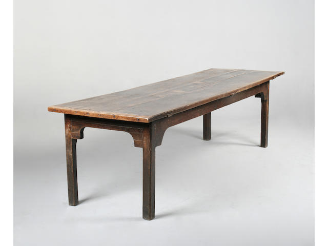 A 18th century provincial oak and elm refectory table
