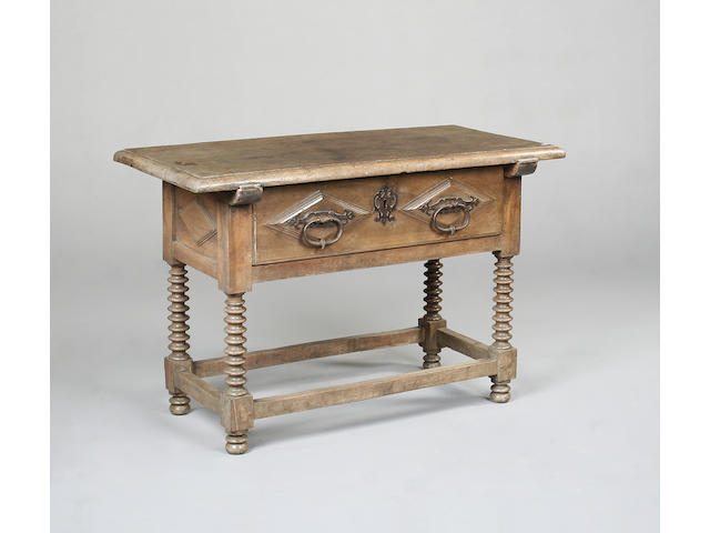 A late 18th/ early 19th century Spanish walnut side table