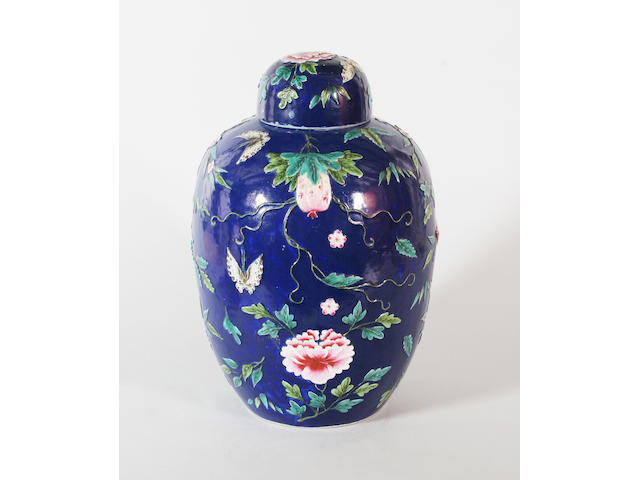 A Chinese relief decorated vase and cover early 20th century