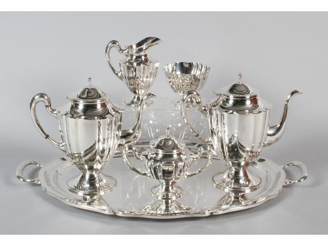 A 20th century Mexican five piece tea set with matching twin handled tray Stamped 'Sterling 925',  (6)