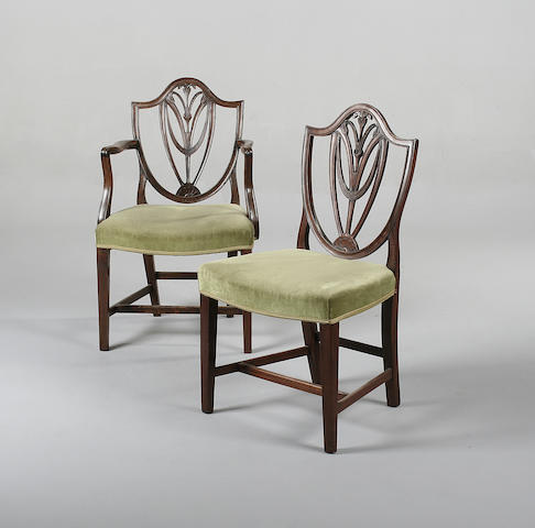 A set of six Hepplewhite style mahogany dining chairs