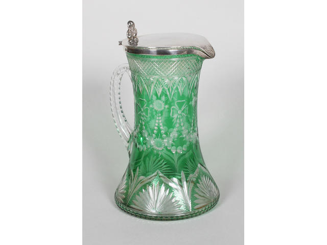 A Stourbridge green flashed and cut glass silver mounted claret jug Circa 1901