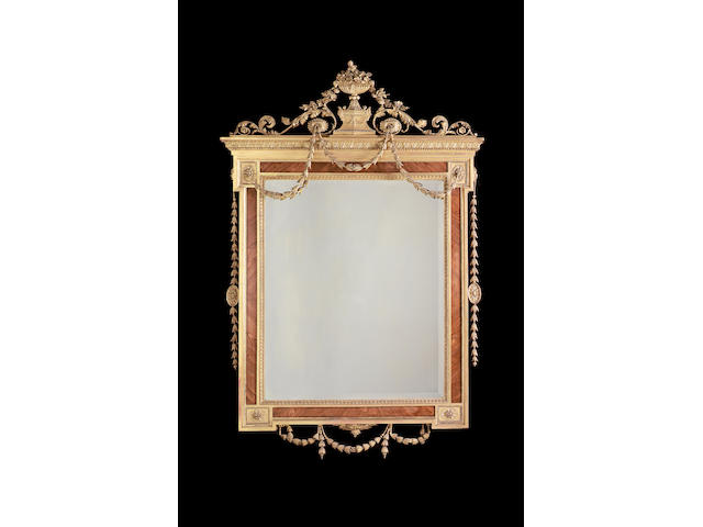 A Neo-Classical style tulipwood and gilt composition mirror