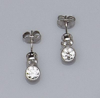 A pair of diamond drop earstuds