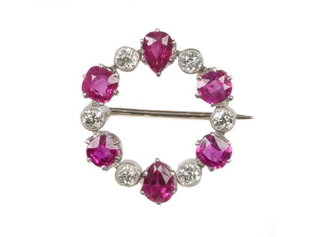A ruby and diamond hoop brooch