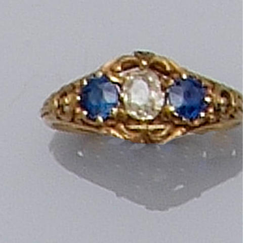 A sapphire and diamond three stone ring,