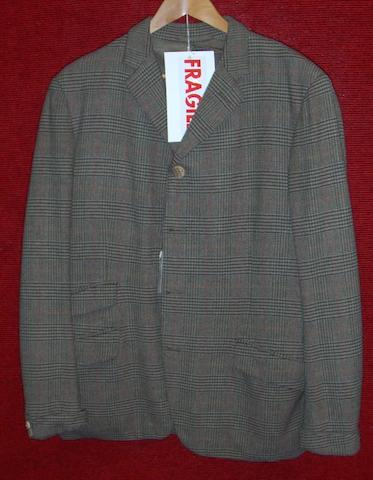 David Niven from Casino Royale, 1967 A green and brown checked tweed jacket,