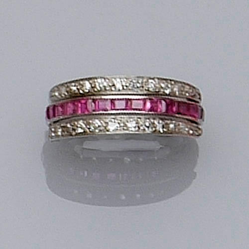 A ruby, sapphire and diamond swivel eternity ring