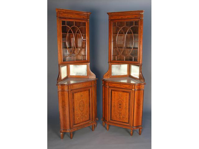 A pair of Edwardian Adam Revival satinwood corner display cabinets