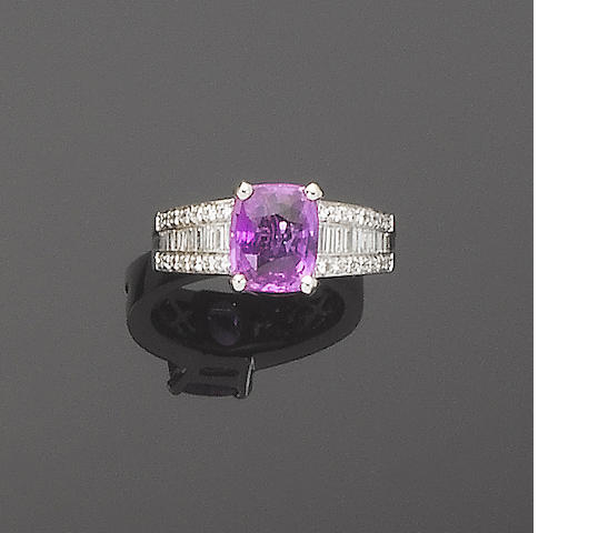 A pink sapphire and diamond dress ring