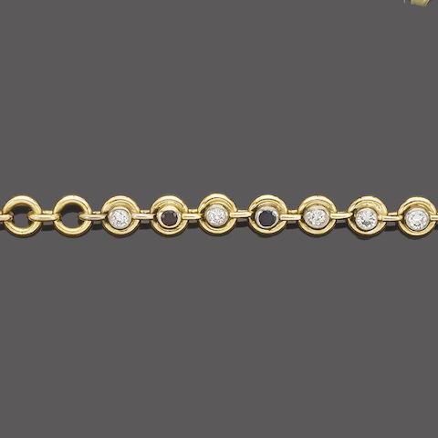 A diamond, sapphire and ruby line bracelet