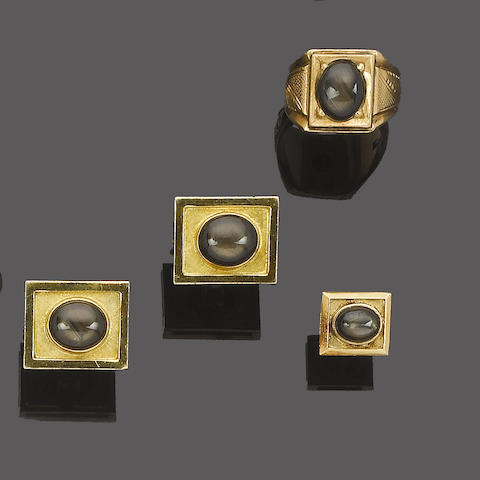 A black star sapphire ring, cufflinks and lapel pin suite (3)