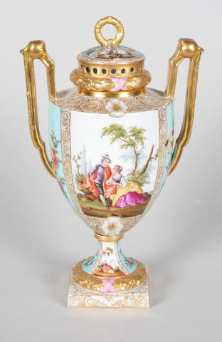 A Dresden twin handled vase and cover