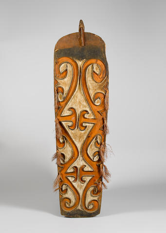 An Asmat shield and a Sepik food hook 43¼in (110cm) 2