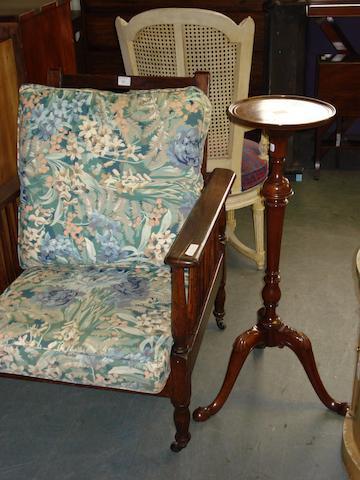 An oak framed armchair with cushions