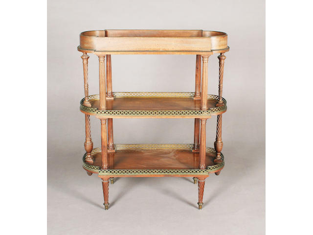 A 19th century English Louis XVI design figured mahogany three tier etagere