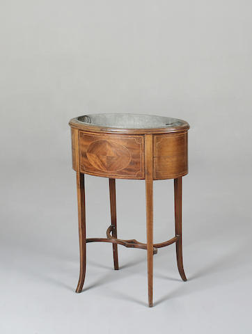 An Edwardian mahogany and inlaid jardinière stand