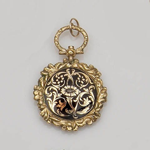 A Victorian enamel portrait locket