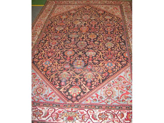A Hamadan carpet West Persia, 318cm x 209cm