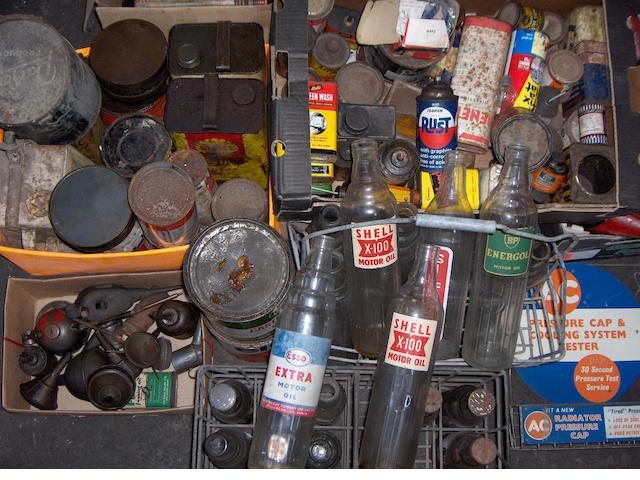 Assorted oil bottles, tins and cans,