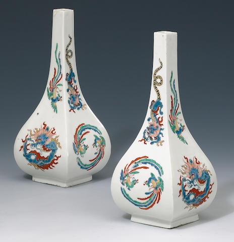 a pair of kakiemon 4 sided vases on metal bases