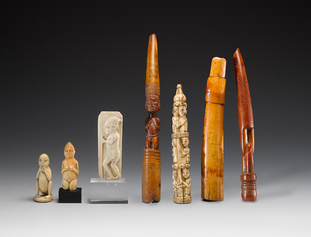 Four African ivory artefacts 4½in (11.5cm) 4