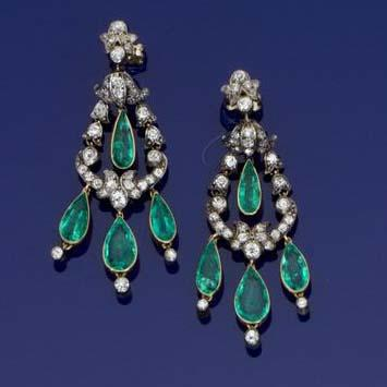 An early 20th century pair of emerald and diamond girandole earrings