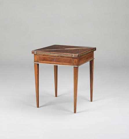 An Edwardian rosewood envelope card table
